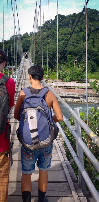 Crossing the river by a bridge on the way to the jungle of Bukit Lawang in Sumatra