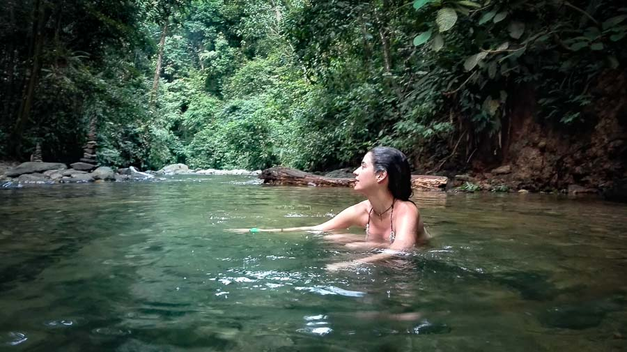Bathing in the Bukit Lawang Jungle Camp River in Sumatra. Southeast asia trip in 20 days