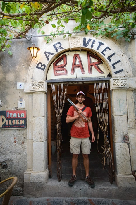 Dani at the door of the Bar Vitelli must see in Savoca Sicily Italy