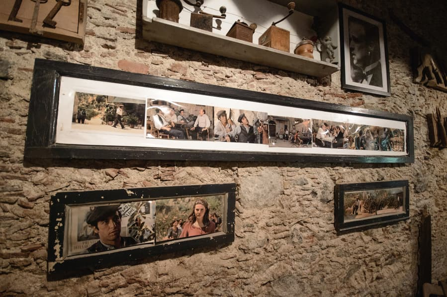 Interior of the Vitelli Bar with photographs of scenes from the Godfather in Savoca Sicily Italy