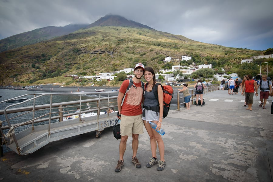 New arrivals to the port of Stromboli Volcano in the background Italy Sicily