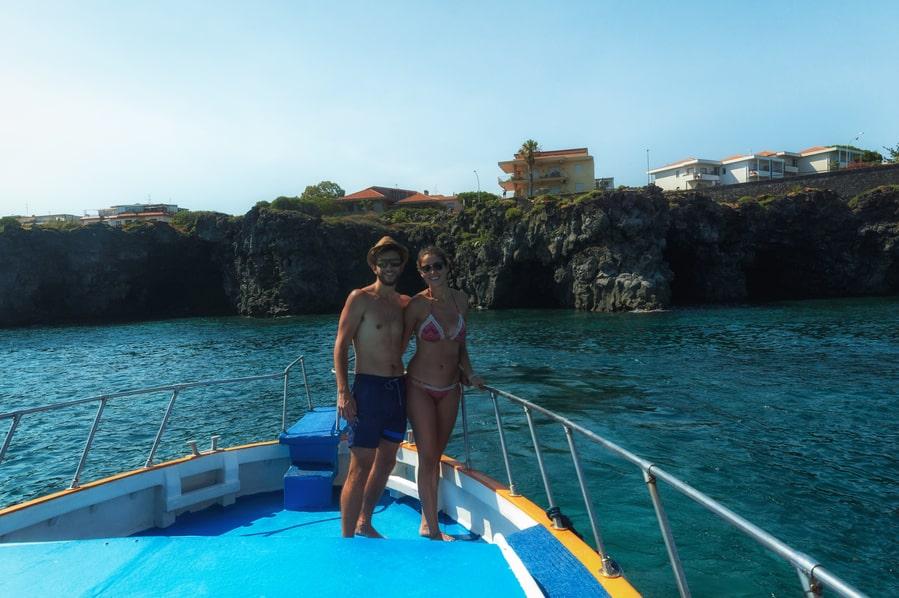 Excursion by boat through the Faraglioni of Aci Trezza Sicily Italy