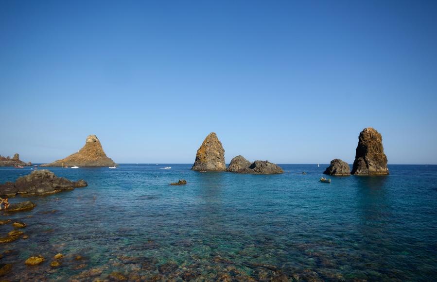 Faraglioni o Isole dei Ciclopi Sicily Aci Trezza in one day Italy