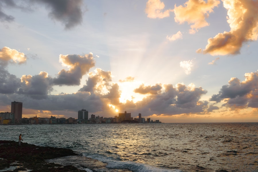Sunset on the Malecón with the neighborhood of Vedado in the background Havana Cuba