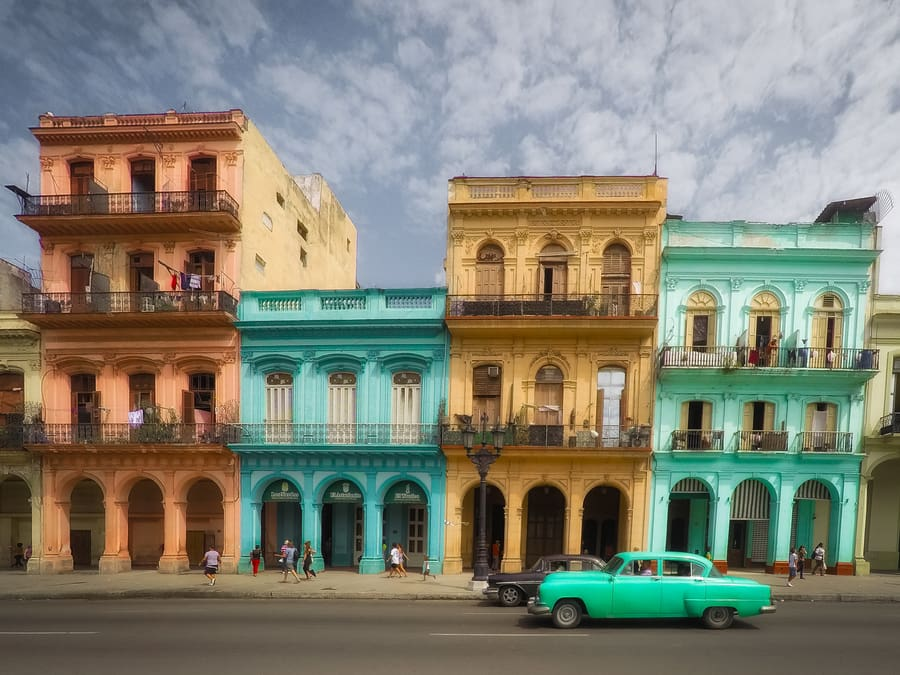 Colorful houses in front of the Capitol Havana Cuba Things to do in Havana