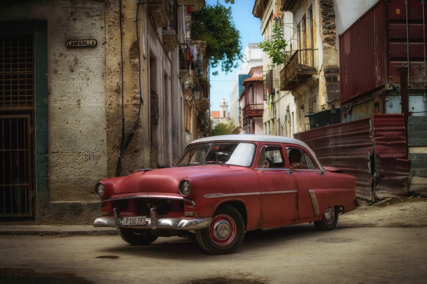Old red car Lamparilla street old Havana Cuba. Top things to do in Havana.