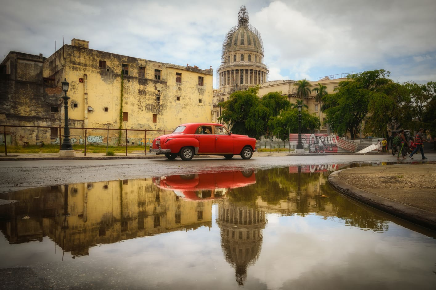 Red car reflection capitolio centro havana