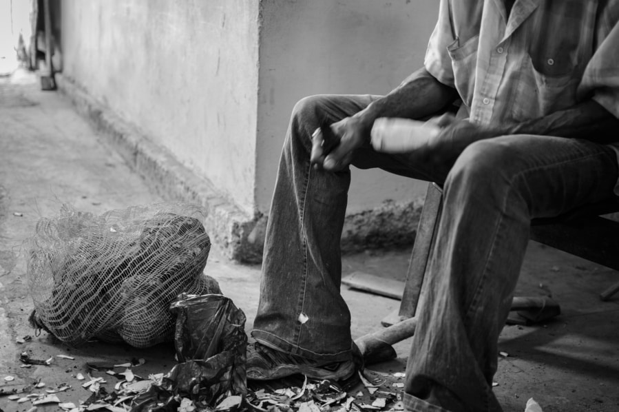 Peeling yucca in Havana Cuba black and white photography guide to top things to do in Havana Cuba