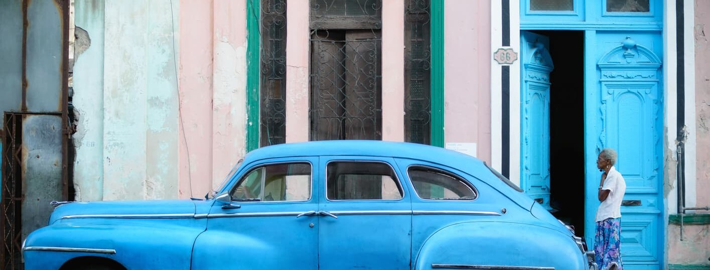 blue car cuban women