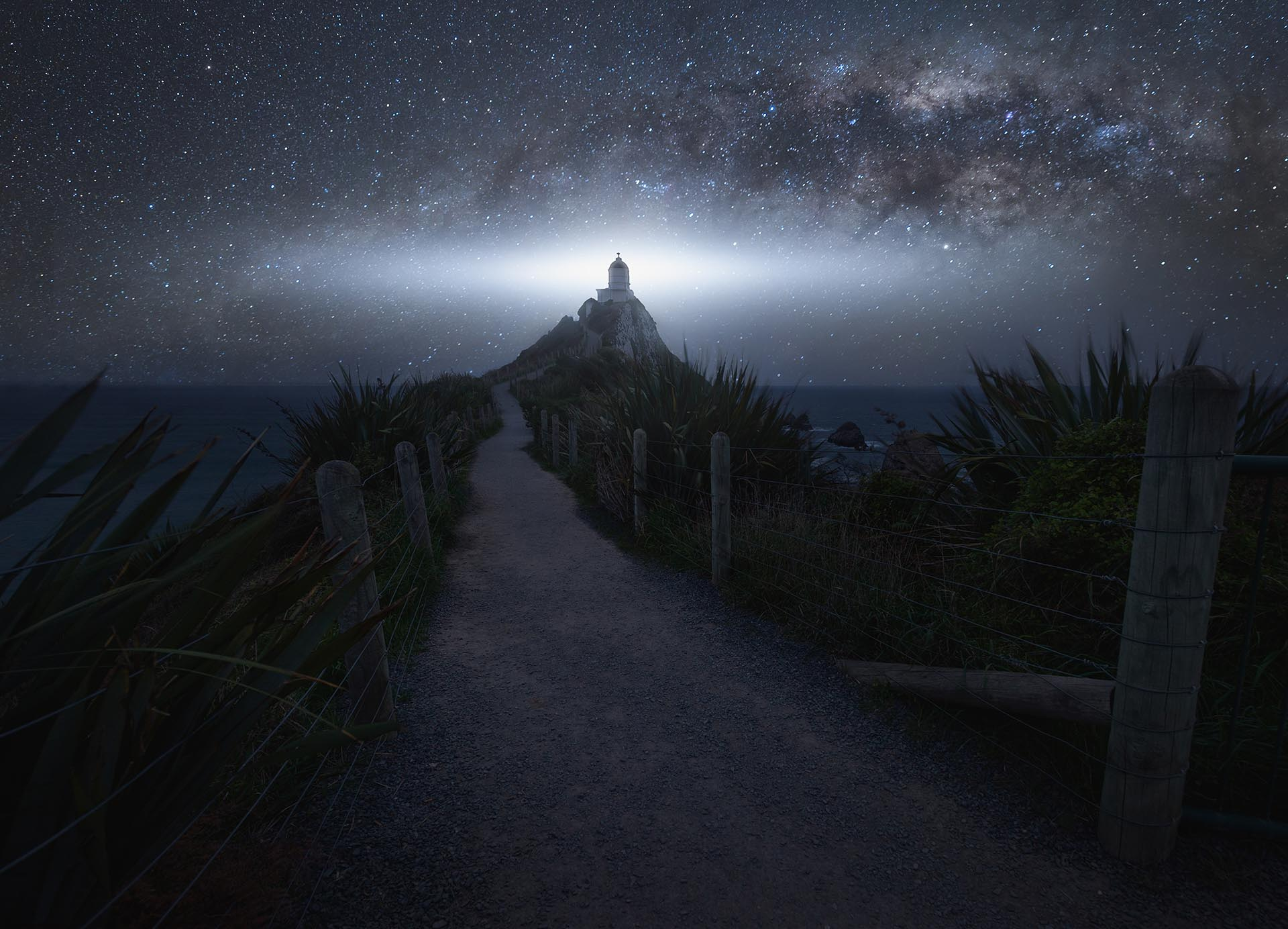 Nugget Point lighthouse Miljy Way Starry night New Zealand