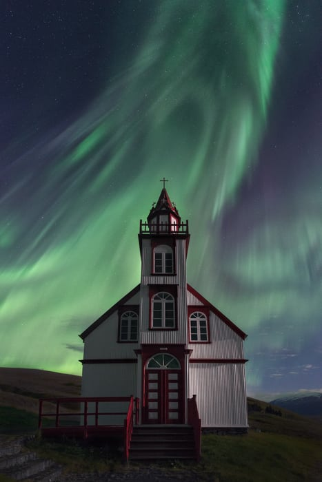 white church northern lights iceland