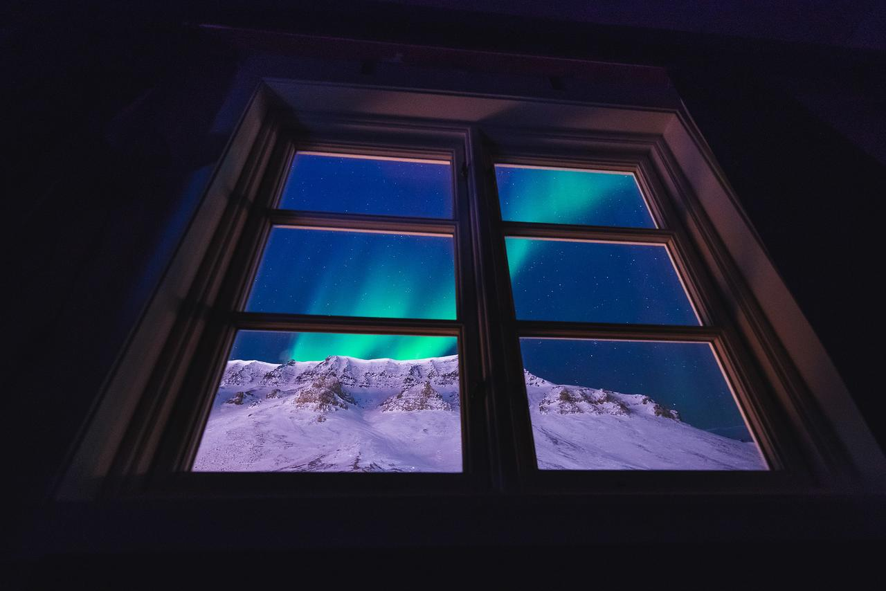 northern lights in norway from the window of your hotel